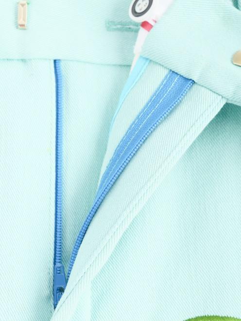 Брюки-клеш с декоративной вышивкой - Деталь1